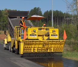 """Chip Spreader (Road Construction - Spreader) Spread """"aggregate"""" (Rocks and other particles) in the sealing process of road construction. (paving, conveyor belt, traction, diesel)"""