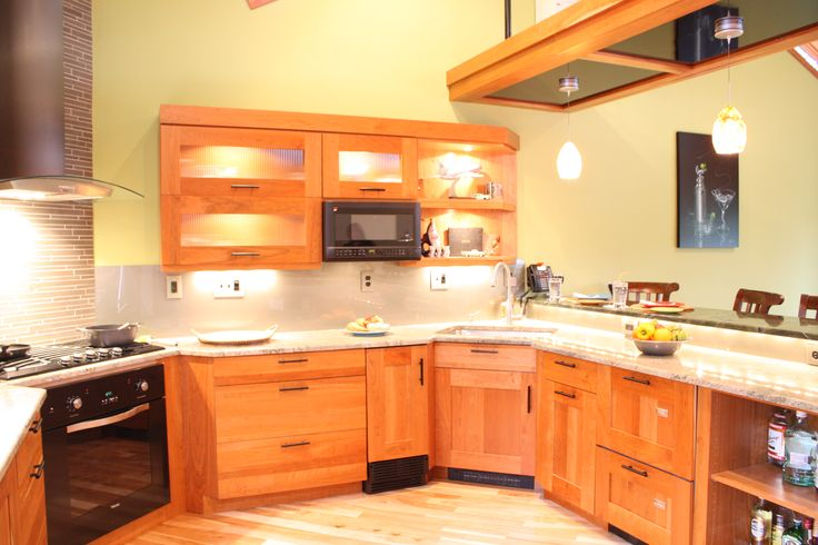 Cherry wood cabinets corner sink built in microwave for Cherry kitchen cabinets with glass doors