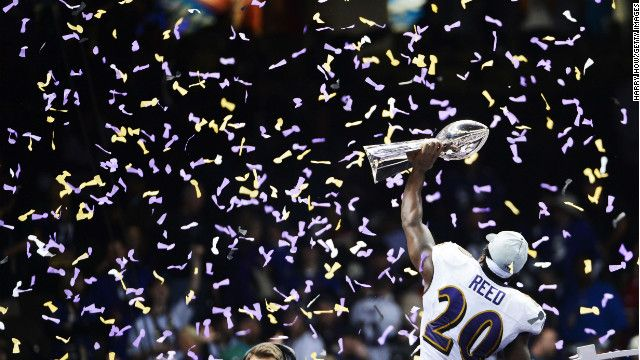 Ed Reed of the Baltimore Ravens hoists the Vince Lombardi Trophy after the win.
