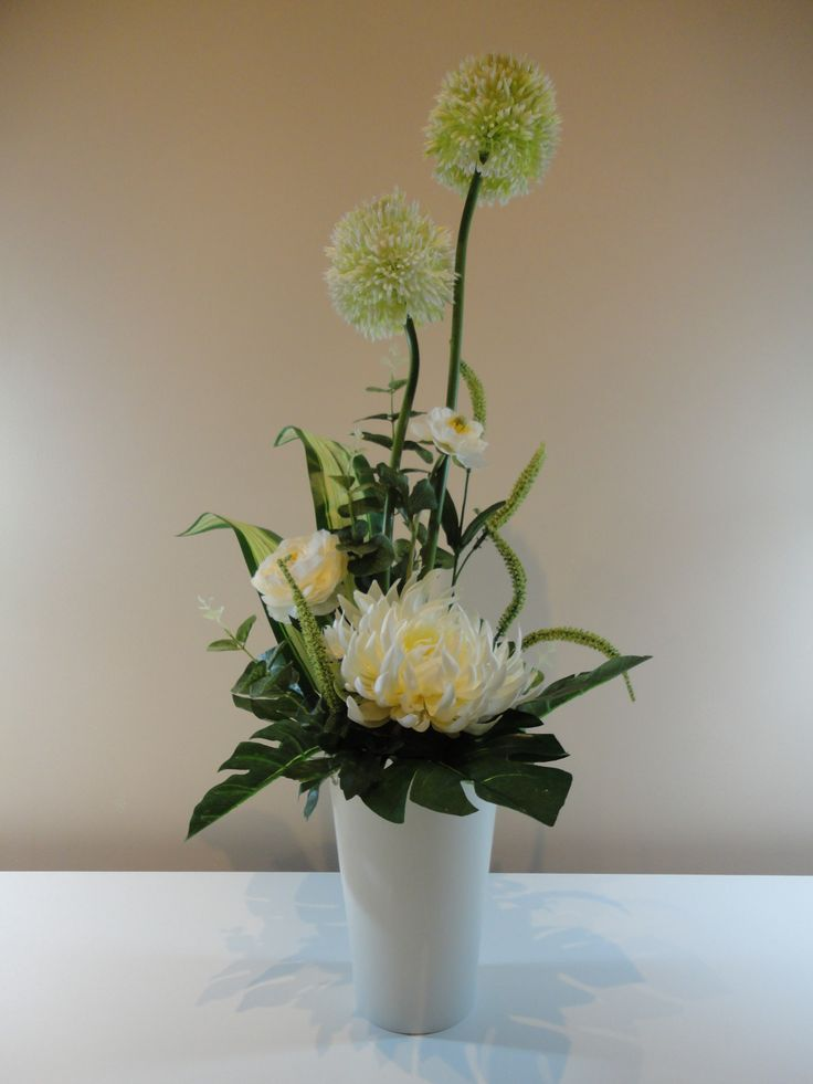 Say it with flowers that last and last! No-one will be able to tell that they aren't the real deal. The Lasting Flower Arrangement in White is a stunning artificial arrangement that would make a perfect gift for just about any special occasion.