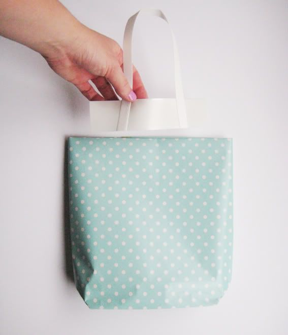 So... DIY gift bag. Could even use ribbon for handles and fabric for bags! Burlap bags would be cute