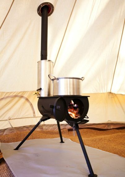 Portable wood stove with water heater attachment on chimney. Can be used  indoors or out. Looks like a useful item for our