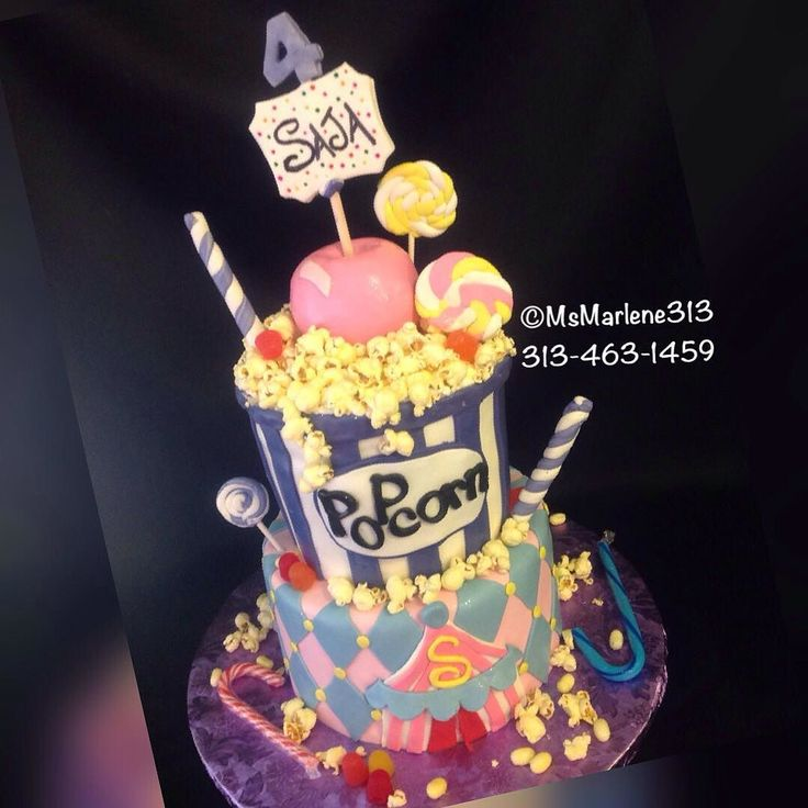 2 Tiered Carnival Themed 4th Birthday Cake with Popcorn Bucket Popcorn Candy Apple and Candy Assortment by #msmarlene313 #3134631459 #2tiercake #carnivalcake #popcornbucketcake #popcorn #candyapples #suckers #saja #candy #cakequeenmarlene #cakelady313 #customcakesdetroit #detroitscakelady #detroitcustomcakes #designercakesdetroit #detroitcakes #madeindetroit #313 #msmarlene313