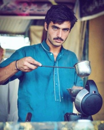 The tea seller (chai wala) has sent Twitter users into a frenzy with his blue eyes.