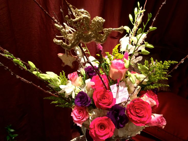Lush blooms, stars + a blinged up cupid celebrate Valentines. Floral Sentiment:  Hydrangea (Pride), Lisianthus (Appreciation), Orchids (Beauty + Friendship),  Roses (Grace + Love), Solidago (Encouragement), Veronica (Fidelity)