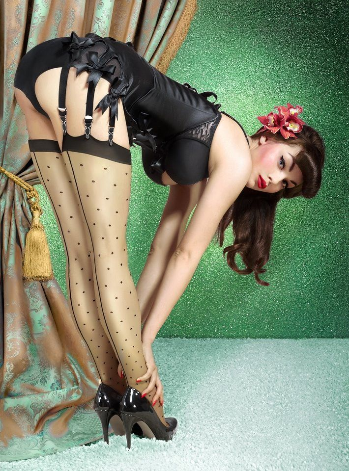 stockings and corset  Pinup Girl http://thepinuppodcast.com features pinup models and pin up photographers.