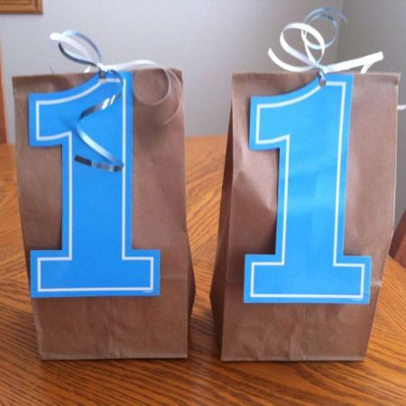 Number 1 treat bags for 1st birthday party.  See more first boy birthday and party ideas at one-stop-party-ideas.com