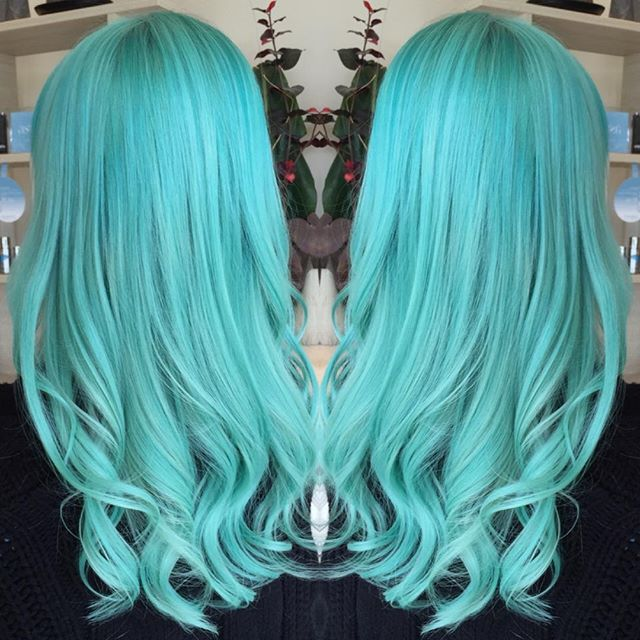 Loose chunky curls and Turquoise hair color by Stevie Vincent of Perth. #hotonbeauty fb.com/hotbeautymagazine
