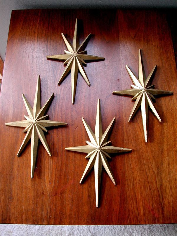Mid-century modern atomic era starburst wall art.  I can think of one million uses for these right now.  I need them