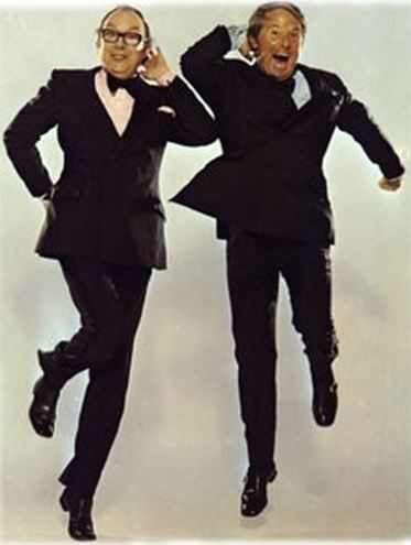 "Promotion image of British comedians Morecambe & Wise in their ""Skip Dance"" pose, performed to Bring Me Sunshine"