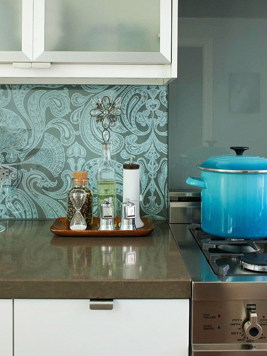 '20 Creative Ways to Use Wallpaper in the Kitchen'. #17: Damask wallpaper with clear glass overlay as a backsplash.