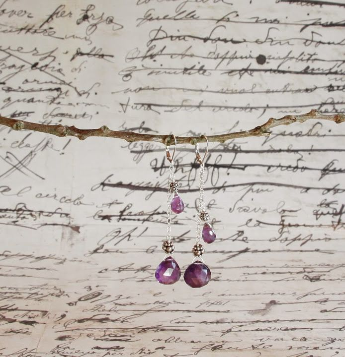 Four amethysts with sterling silver beads on a delicate silver chain