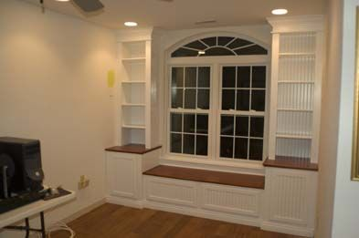 built in bookcases around window ... this might be the perfect design... now to jig it to work around our bay window...