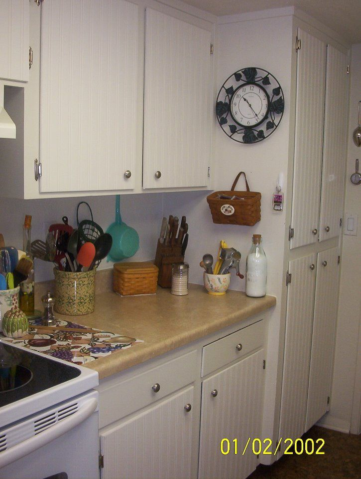 "DIY: ""Beadboard Wallpaper"" on kitchen cabinets - a tutorial...never heard of this product. Looks great though..."