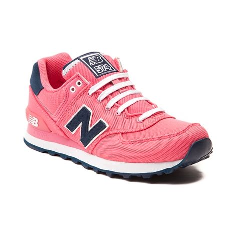 Shop for Womens New Balance 574 Athletic Shoe in Pink Navy at Journeys Shoes. Shop today for the hottest brands in mens shoes and womens shoes at Journeys.com.Sprint into sporty style with the 574 Athletic Shoe from New Balance! The 574 sports a breathable mesh upper with suede leather accents, lace up closure, padded tongue and collar for comfort and support, EVA molded midsole, and durable rubber outsole for grip and traction. Put your best foot forward with the classic style, comfort, and…