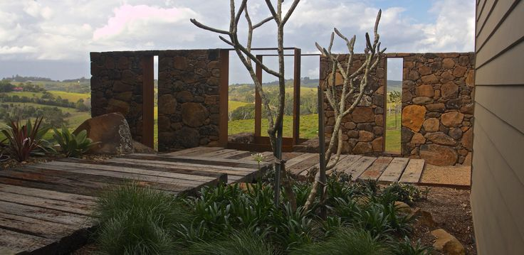 Rock and Corten Steel Sculpture walls frame an entrance courtyard on a Byron Bay Hilltop