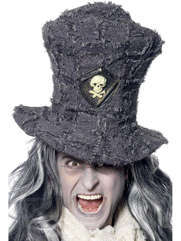 Haudankaivajan hattu. Korkea ja harmaasävyinen hattu jossa pääkallo-koriste.