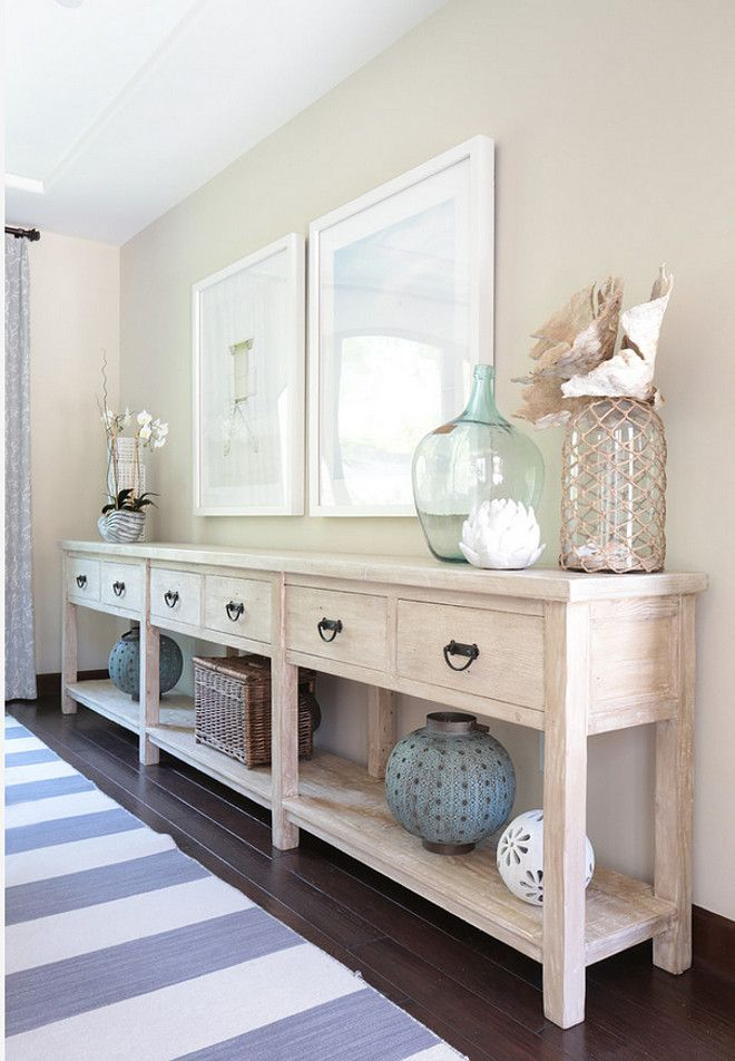 dining room features long sideboard with whitewash finish and coastal decor - Coastal Decor Ideas