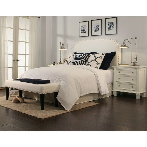 Create a soft and elegant look to your bedroom's decor with this charming white headboard. Featuring sturdy composition, this headboard provides superior support, while the soft white fabric delivers
