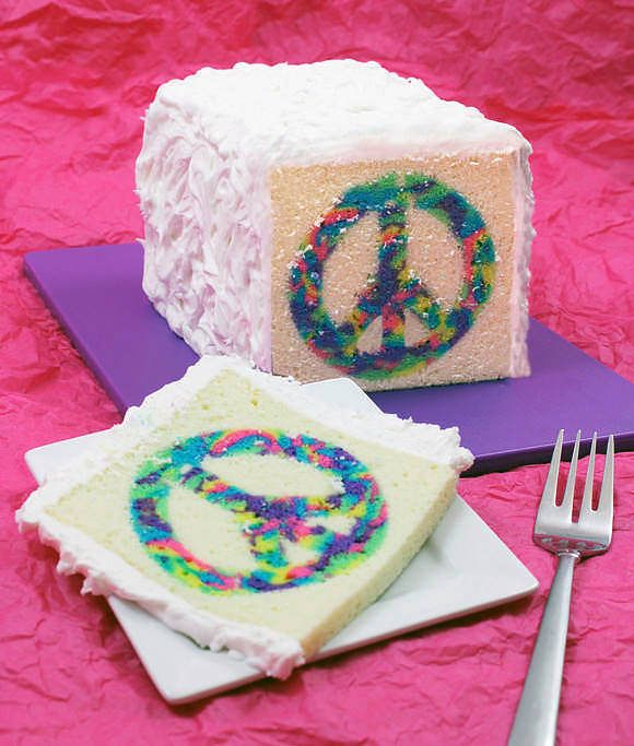 DIY Peace Cake.  Uses cookie cutters to make center.  Batter added and baked again.  Great to use alphabets, cookie cutters, might be fun for a baby sex reveal or for a tea party.  Cute idea.