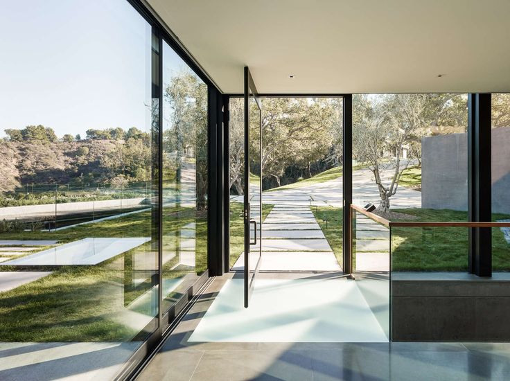 The Oak Pass Main House uses an 'upside down' program, with public spaces above the bedrooms, which are buried into the hill and beneath a green roof of edib...