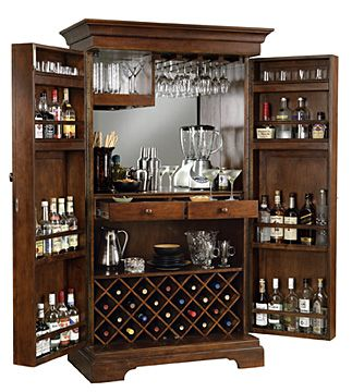 Alcohol armoire..... kind of an awesome way to have an in home bar and being able to hide it