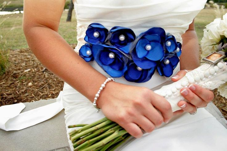 """You can incorporate that """"something blue"""" into your wedding, in a unique way! - Your wedding dress sash - Your flowers  - Your shoes  #wedding #somethingblue #weddingsash #weddingdress #ravenluxuryevents  Photo Source: https://www.flickr.com/photos/inparistexas/6860294292/"""