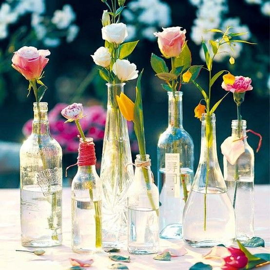 Recycle old wine bottles and use them as a centerpiece for your wedding breakfast. Simple and elegant