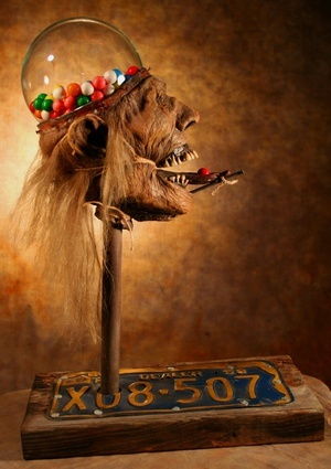 ummm I don't know: Head Gumball, Antiques Stores, Candy, Geinbal Machine, Zombies Gumball, Gumball Machine, House, Zombies Head, Monsters Sculpture