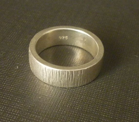 This is a lovely and simple handmade sterling silver ring which has been hammered to achieve the textured effect. Highly polished, this is a