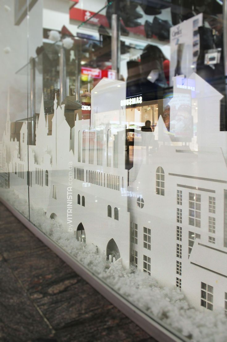 """Winter window display design for shoes store """"EGLE"""", Ukraine. Snowy winter in the city."""