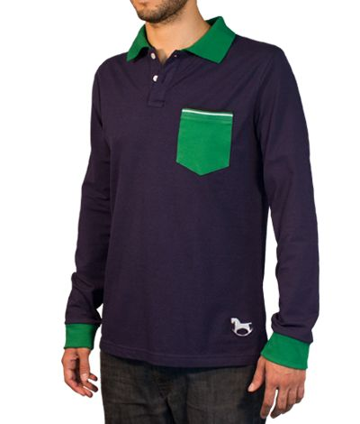 Blue Polo shirt with long sleeves, 100% cotton. This Polo shirt has its pocket, collar and cuffs colored in green. The tape inside its collar is light green and matches with the stripes of the upper pocket. At the bottom of this garment stands out a gray toy horse logo. http://www.tailor4less.com/en/collections/custom-polo-shirts/stylo/mestizo