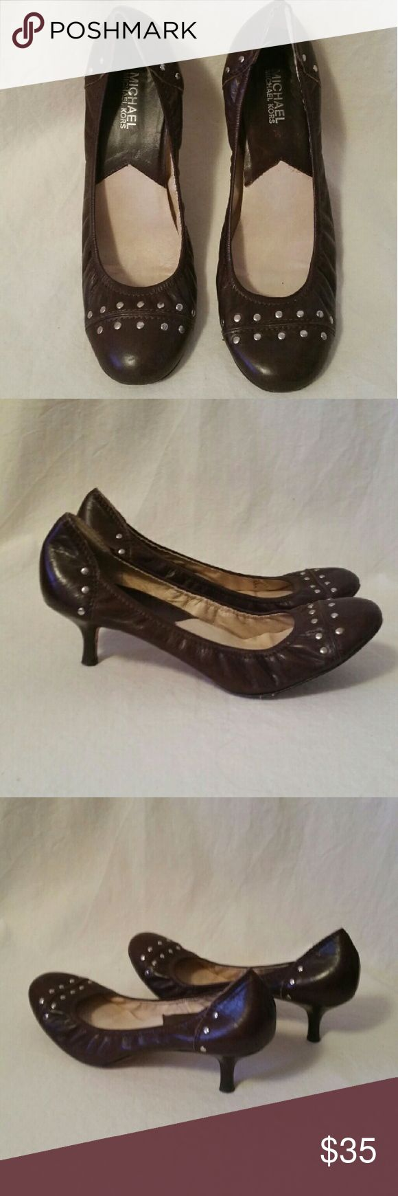 Michael Kors Ballet Heels size 10 This is a pair of super cute brown leather Michael Kors Ballet heels in a size 10. The heel is small about 2 inches and the ballet fit makes them incredibly comfortable. These are in great shape. Michael Kors Shoes Heels