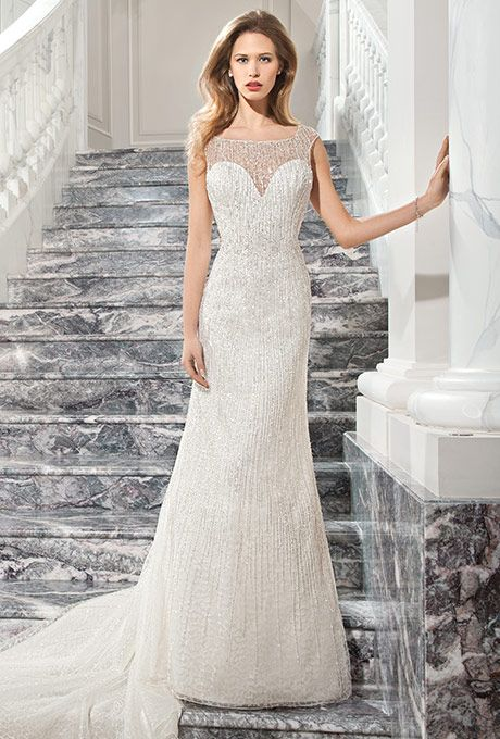 Brides: Demetrios - Couture. This shimmering, modified a-line gown with illusion neckline features sparkling beaded tulle over a strapless sweetheart silhouette. The beaded illusion back features a button closure and chapel train.