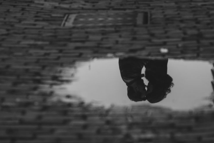 after the rainfall. engagement shoot in Distillery District, Toronto, Ontario, Canada