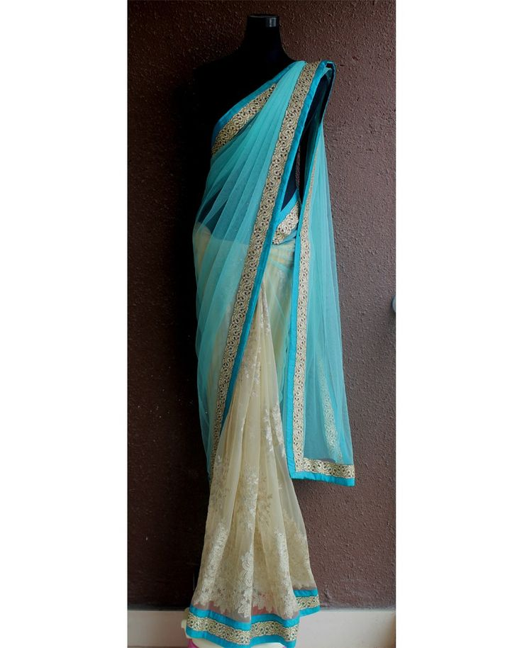 Sea green and champagne gold half and half sari 1. Champagne gold and sea green net sari2. Champagne golden net pleats with delicate zari work highlight 3. Sea green net pallu with zardozi work4. Border embellished with zari cutwork with turquoise accent5. Comes with unstitched blouse material