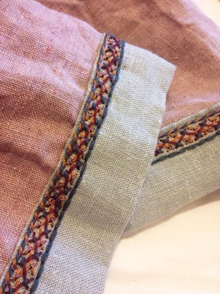 Embroidery trim on a linen Viking dress - double Herringbone, as found at the Mammen site, with some extras.