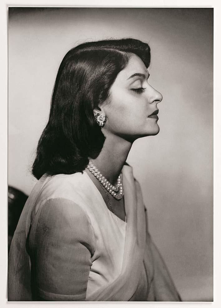 "Maharani Gayatri Devi of Jaipur, age 21, at the time of her marriage, 1940.She was born into the royal family of Cooch Behar, one of around 560 ""princely states"" that existed in India. She was just 12 when she first met the then-21-year-old Maharaja of Jaipur, the urbane, polo-playing Sawai Man Singh II. The prince already had two wives, both essentially for political reasons, but in 1940 the pair shocked blue-blooded society by announcing their plans to marry."