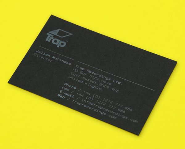 Logo and black business card with white ink print finish designed by Red for UK independent recording studio Trap