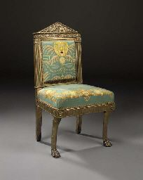 AN ITALIAN EMPIRE CARVED GILTWOOD SIDE CHAIR ATTRIBUTED TO LORENZO SANTI (D.1839), ROME, FIRST QUARTER 19TH CENTURY. Almost certainly commissioned by Cardinal Fesch (d.1839) in Rome, uncle of Napoleon I; moved to his house in the Rue de Mont Blanc, Paris, circa 1806; probably amongst those sold in Paris, 17 June 1816, either lots 445 or 446. Probably bought by William Beckford, Fonthill Abbey, Wiltshire