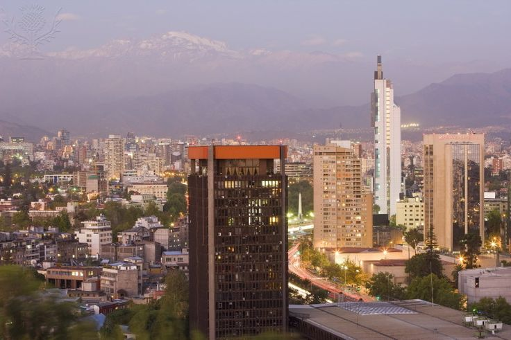 City skyline and the Andes mountains at dusk, Santiago,...