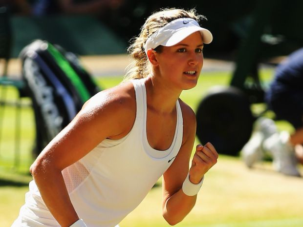Eugenie Bouchard of Canada celebrates match point and winning her Ladies' Singles semi-final match against Simona Halep of Romania on day ten of the Wimbledon Lawn Tennis Championships at the All England Lawn Tennis and Croquet Club  on July 3, 2014 in London, England.