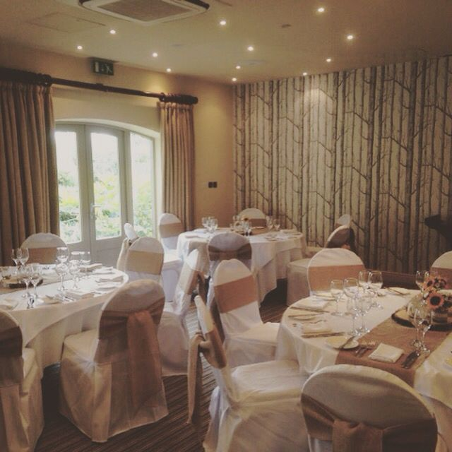 Chair covers with hessian sashes