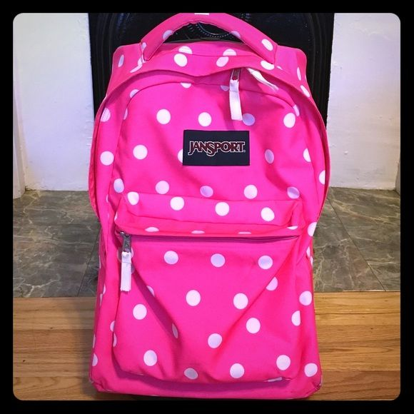JanSport Pink/ White Wheeled Superbreak Backpack Brand: JanSport Color: Pink w/ White Polka Dots Style: Wheeled Superbreak. This backpack is VERY spacious and super CUTE! I have not used it at all this semester because it's a little large for my needs. Good condition. The wheels and lower back guard have some scuffing due to rolling but just your normal wear and tear. Great for traveling or school! Any girly girl would love this backpack! Jansport Bags Backpacks