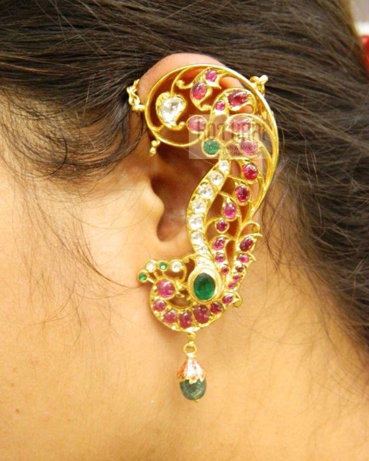Full ear earring with peacock motif