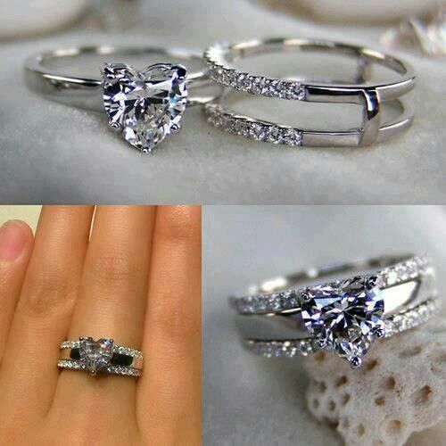 Heart diamond ring. Different but cool idea for the wedding band.