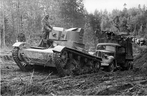 Soviet twin-turreted t-26 supply convoy is led by the Finnish troops somewhere in the East Karelian forests in June-July 1941 - pin by Paolo Marzioli