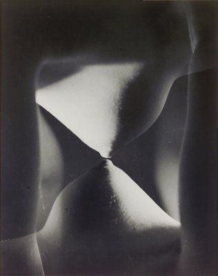Erwin Blumenfeld- There is something about the isolation of a body part, that makes it inherently bizzarre, here I see a single breast and nipple touching with itself via the means of double negative, this creates a geometric hourglass shape that is interesting to look at.