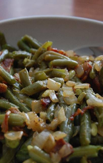 This is how my family made green beans when I was growing up...  fresh green beans 1/2 pound bacon 1/2 small onion, diced 1 teaspoon cider vinegar salt and pepper to taste  Cook beans until tender. While they are cooking fry bacon; remove from pan and crumble. Saute onions in bacon grease and remove leaving drippings behind. Drain beans and combine with bacon, onions, vinegar, and seasonings. Cook and toss over low heat. Enjoy!
