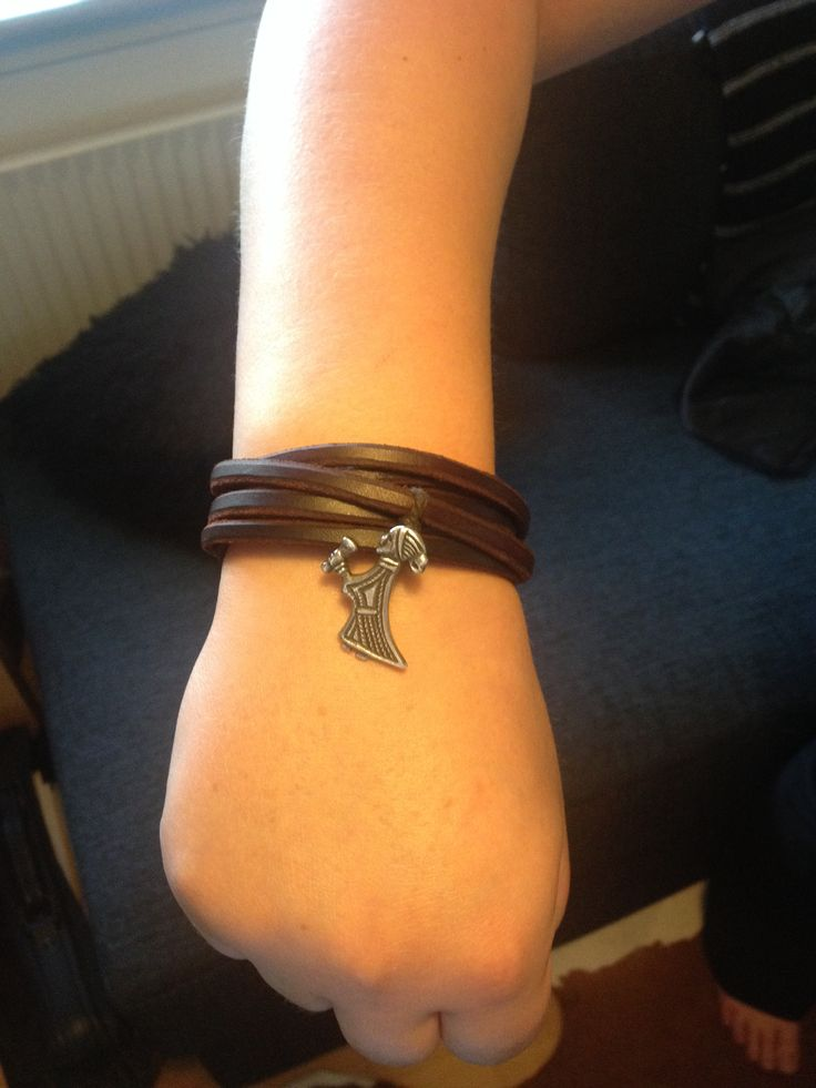 A Leather and silver bracelet.